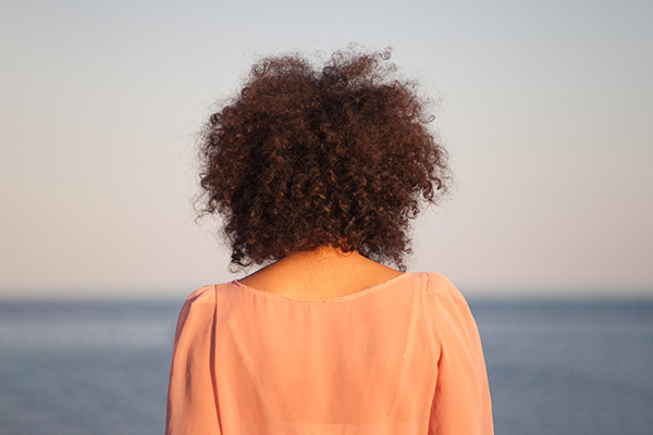 Cloudless image - back of woman staring off into the distance